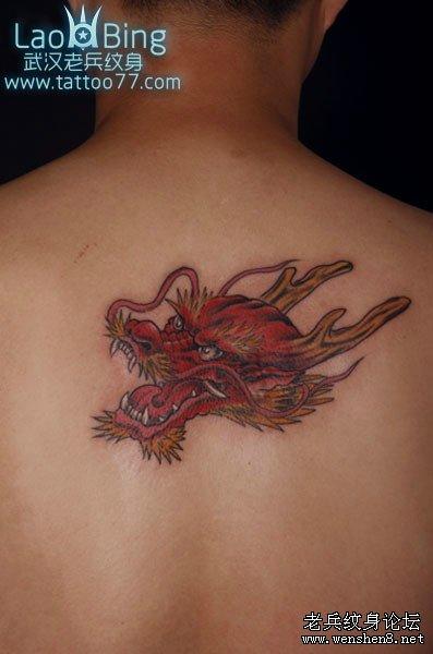 纹身常识  龙的形象是集中了许多动物的特点:鹿的角,牛的头,蟒的身,鱼