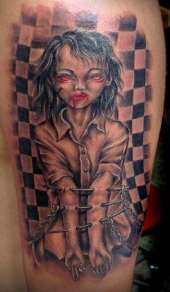 欧美纹身图案:手臂另类欧美娃娃纹身图案