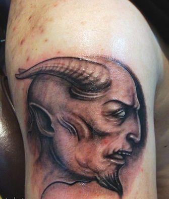 一款另类时尚手臂恶魔纹身图案纹身图片