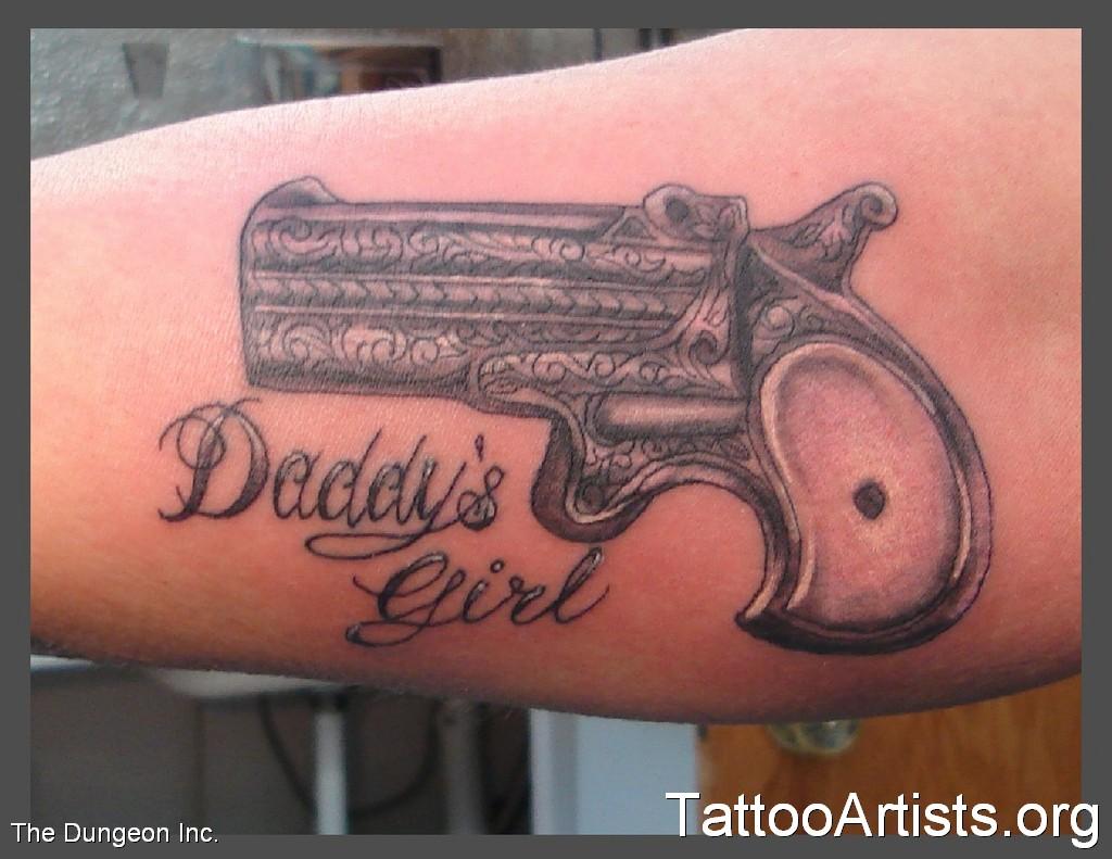 武汉专业纹身(tattoo)店:手臂内侧手枪字母纹身图案图片