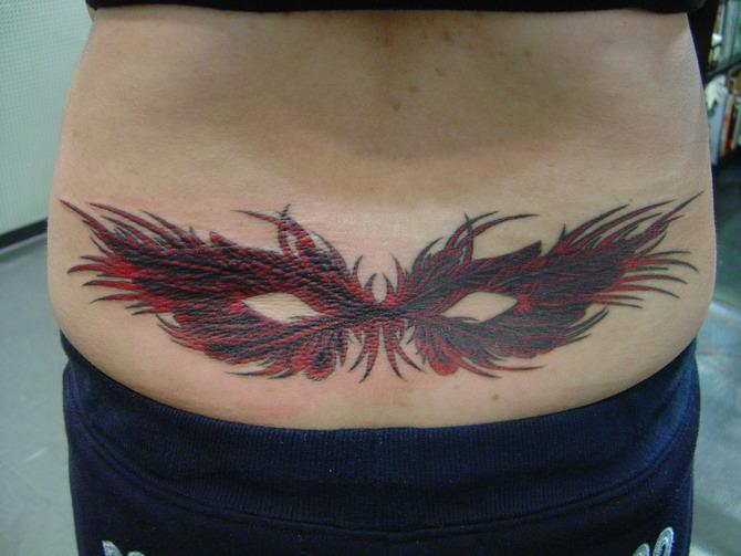 腰部文身图案大全:后腰部羽毛腰花纹身图案图片