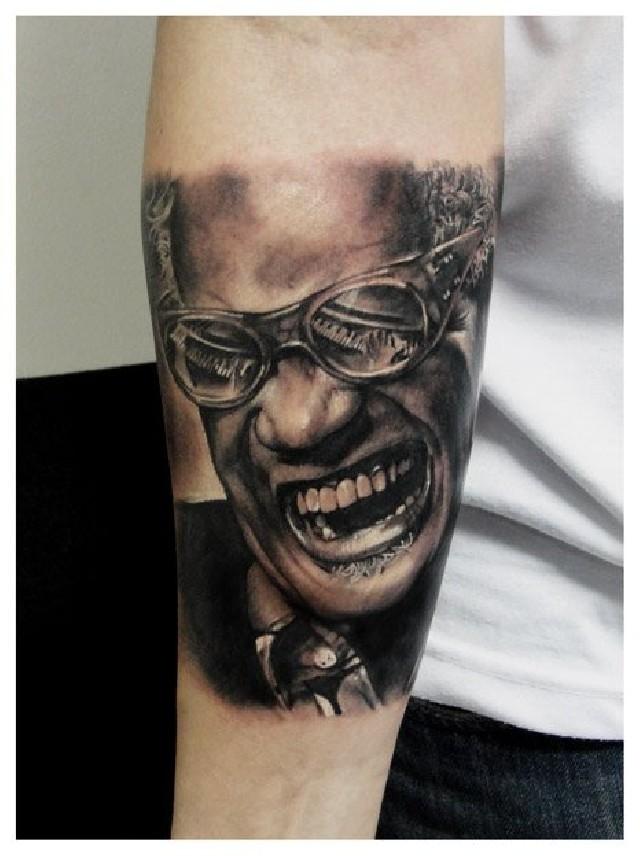 武汉最好纹身店:手臂肖像文身(tattoo)图片