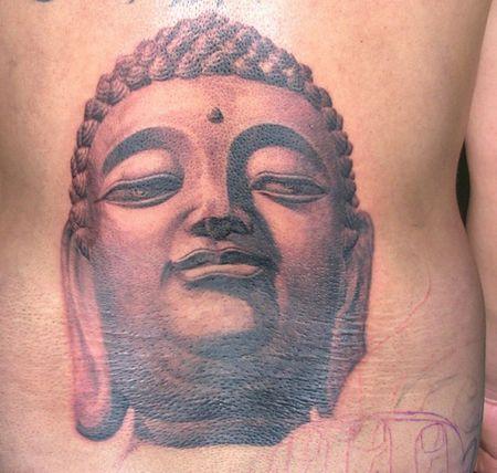 一款腰部佛头纹身图案图片