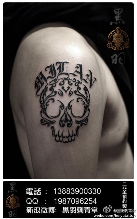 男人手臂酷酷的图腾骷髅纹身图案