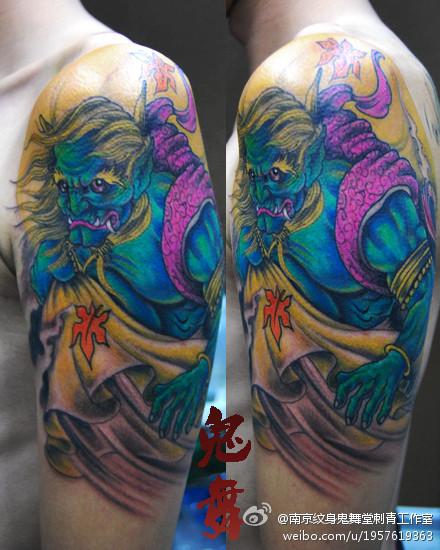 手臂一款超酷的风神纹身图案