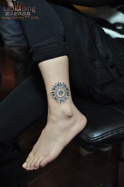 武汉哪里纹身最好,老兵纹身打造的腿部情侣图腾太阳图片