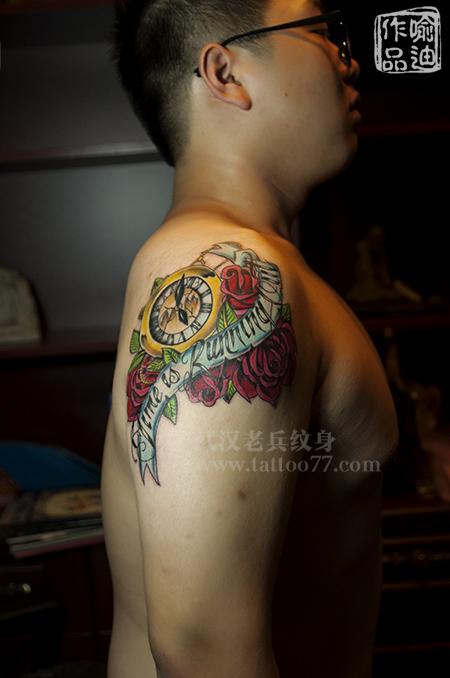 大臂school时钟玫瑰纹身出自武汉最好纹身店