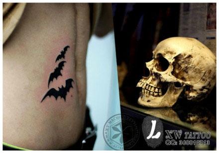 女生腹部时尚经典图腾蝙蝠纹身图案 高清图片