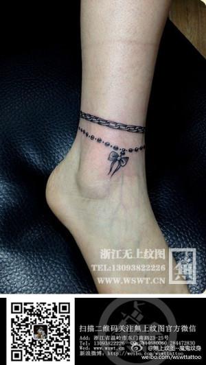 女生脚腕小巧潮流的蝴蝶结脚链纹身图案图片