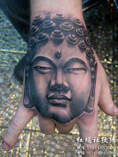 推荐一款时尚好看的手背佛头纹身图案