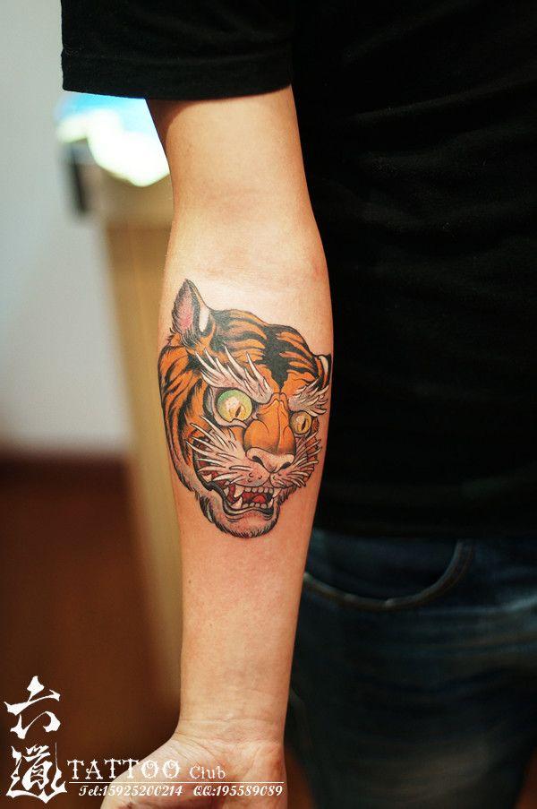 推荐一款男人小臂霸气时尚的老虎纹身图案