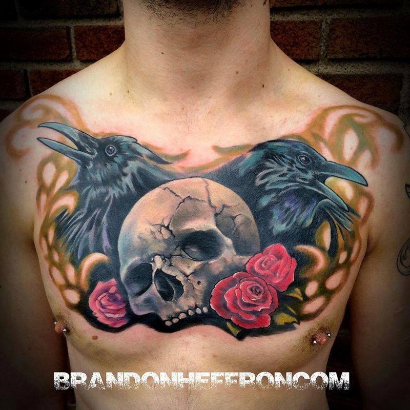 男人胸口一款霸气时尚的骷髅玫瑰纹身图案