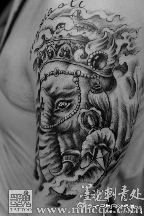 象神包小臂纹身; 一款大臂象神文身图案由武汉刺青店