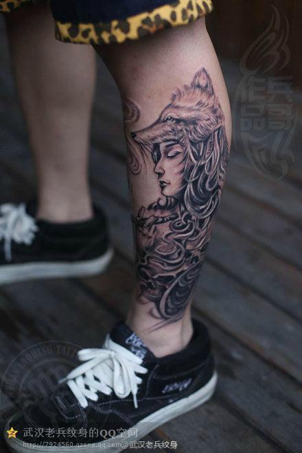 武汉专业纹身店打造的遮盖作品--小腿狼女纹身作品