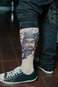 武汉最好纹身店打造的小腿佛头纹身作品