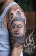 武汉最好纹身店打造的大臂如来佛纹身作品