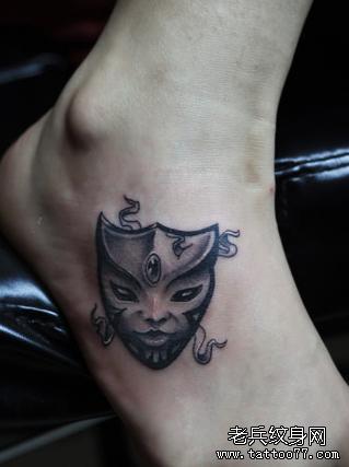 诡异的面具腿部纹身图案图片