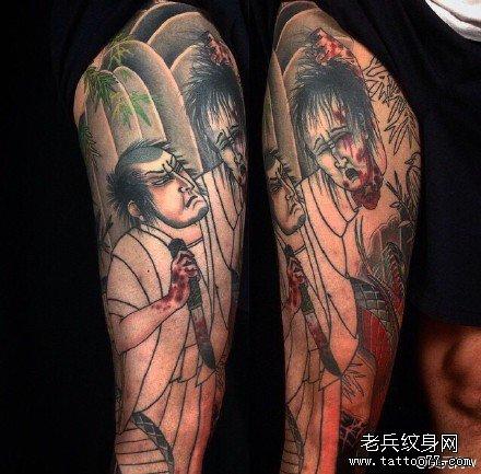 腿部日本杀人头纹身图案图片