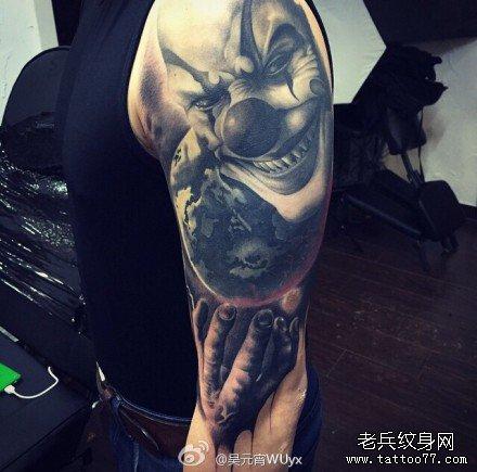 胳膊恶魔小丑肖像纹身图案