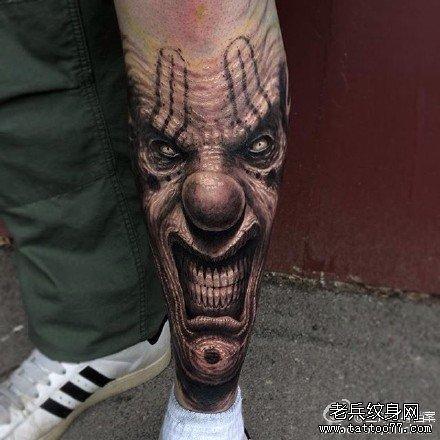 腿部笑恶小丑面具纹身图案