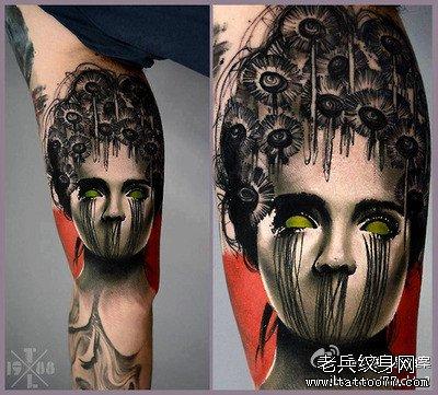 腿部无面脸纹身图案
