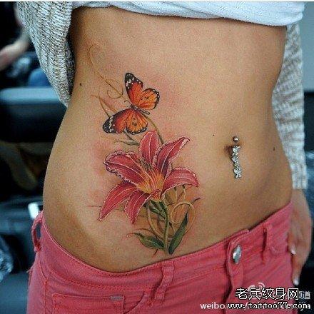 美女腹部小太阳花纹身图片