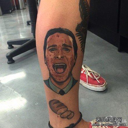 腿部男肖像纹身图案