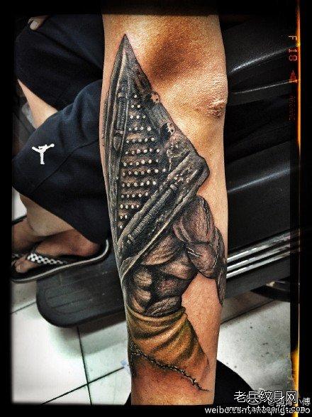 手臂鬼大刀纹身图案